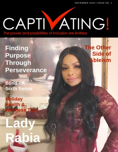 On the cover is our featured guest, Lady Rabia wearing an elegant and festive long sleeve burgundy gown standing in front of a white fireplace covered with Christmas decorations. Her hair is black and left down long and curled.