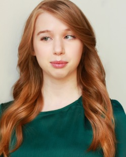 1. Holly Lynn Connor: A professional headshot of Holly, whose long wavy red hair frames her pretty face and she is wearing an emerald green top.
