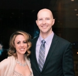 3. Author bio photo shows above the waist shots of Katie and her husband at a gala.