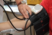 Healthcare professional taking a blood pressure reading of a patient's arm