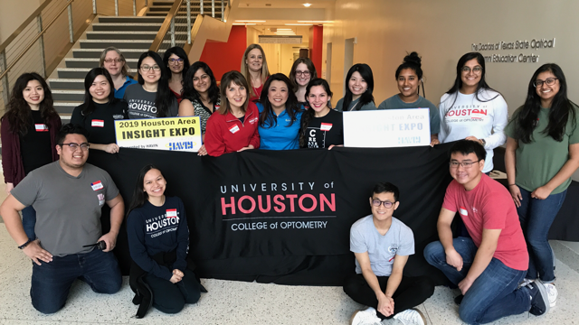 University of Houston College of Optometry volunteers group photo. Chelsea Nguyen is standing in the middle.