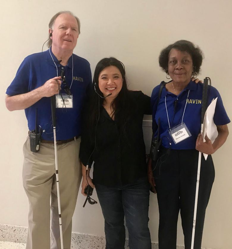 HAVIN Members from left to right: Ron Graham, Chelsea Nguyen, and Minnie Christal. Ron and Minnie are both Board members and wearing their Royal Blue HAVIN T-shirt's, name badges and holding their white canes and we are all wearing our wallow talkies to be in communication with the rest of the HAVIN Committee on our Insight Expo day in 2018.