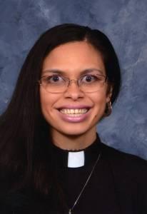 Author bio photo of Rebecca wearing her clergy collar.