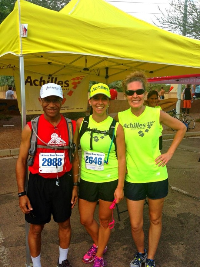 My first 5k I ran with two of my first guides! I am wearing an Achilles International jersey and hat.