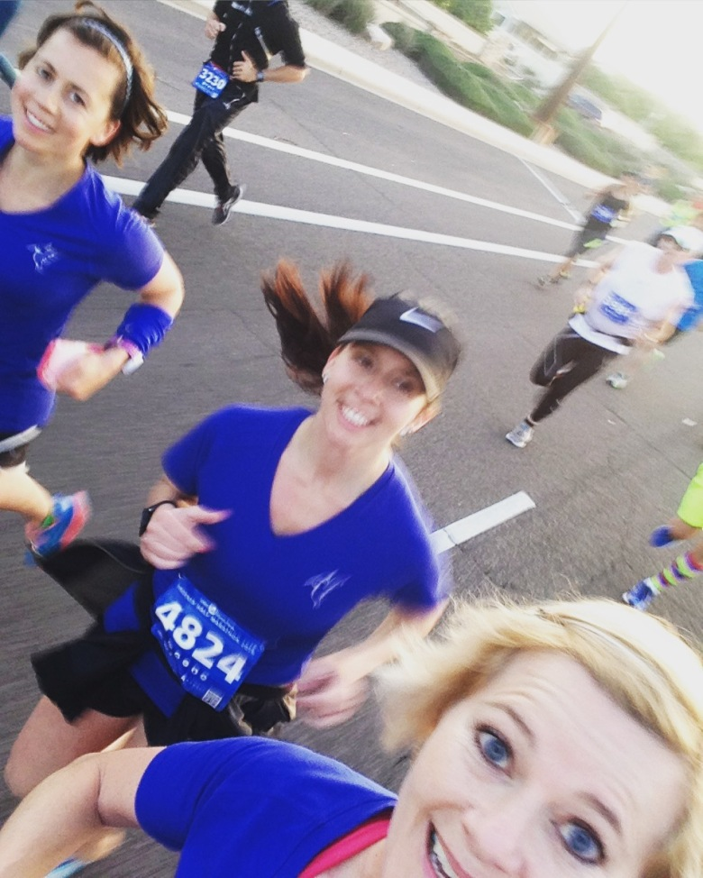 One of my guides is taking a selfie of us running the Phoenix Half marathon. We are all wearing matching bright blue shirts!