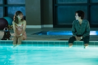 "The film's stars are sitting five feet apart on the edge of a swimming pool dangling their legs in the water. 'Haley Lu Richardson (""Stella,"" left) and Cole Sprouse (""Will,"" right) star in ""Five Feet Apart."" Courtesy CBS Films Lionsgate."