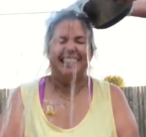 A still shot of Sunny Brous taking the challenge (photo is from www.alstexas.org 5 year Ice Bucket Challenge compilation video).