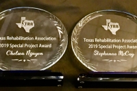 "The header image is a photo of the 2 awards. They are oval-shaped glass on a wooden base and say: ""Texas Rehabilitation 2019 Special Project Award""."