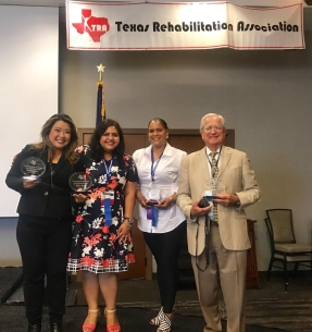 In this photo, Chelsea is holding her award and standing with Rachita Sharma, TRA President and two other fellow Awardees Nicole Rideau (recipient of Marilyn Padgett Extra Mile Award) and Robert Cox (recipient of the Legislative Award).