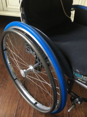 Top picture shows a shiny aluminum wheel and spokes with bright blue tires.