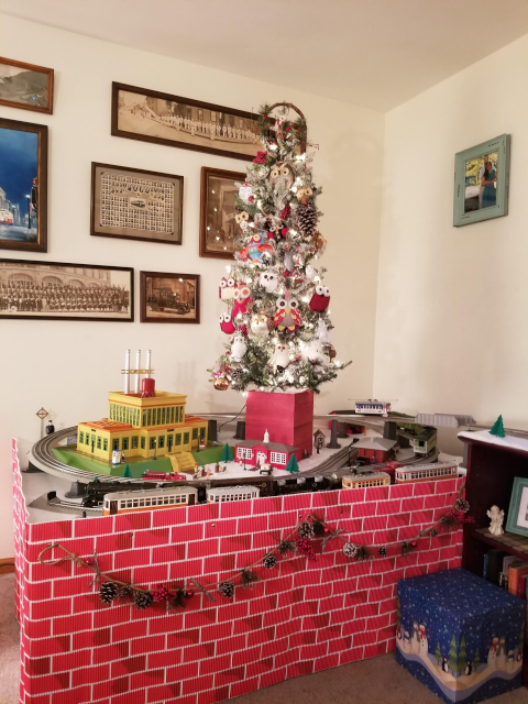 Jeff and Beckie love trains so much that they put a huge train layout under their tree