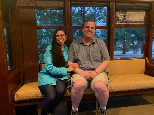 Rebecca and Jeff are both rail fans. In this photo, they are seated in a historic trolley in Minneapolis.